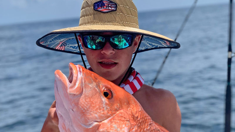 Ethan Defelice with a red snapper that he caught while fishing the SMI blocks with his uncle, Brett Adams.