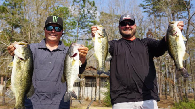 """Cliff Crochet (right) and fellow bass pro Tyler Stewart caught these nice largemouth on a fun """"off day"""" of fishing on Caney last year."""