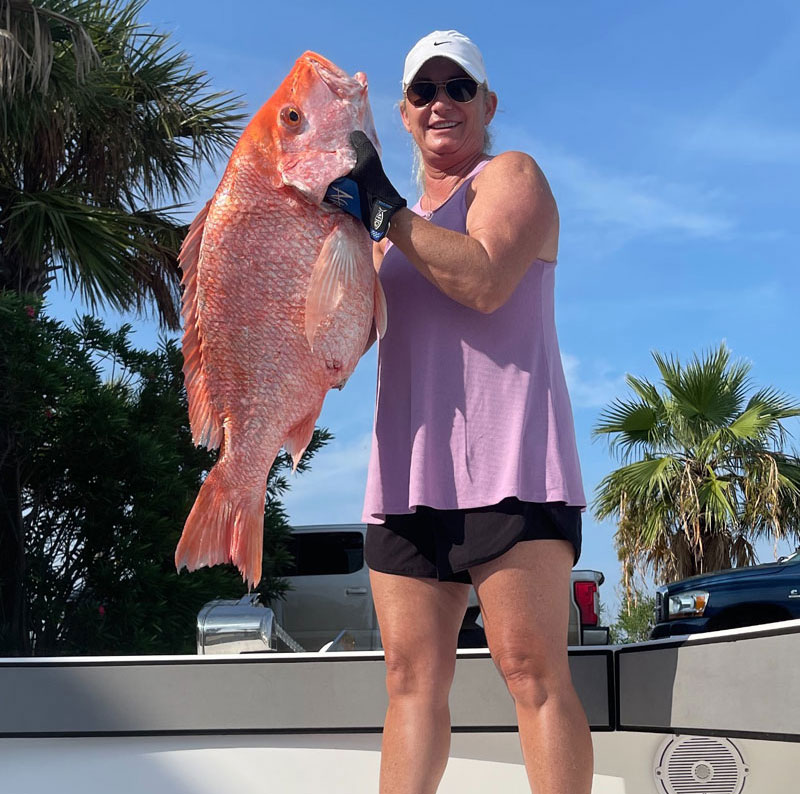 Vickie Clouatre caught this 25-pound, 34-inch red snapper while fishing on her 33 foot Freeman out of Hurricane Hole Marina in Grand Isle.