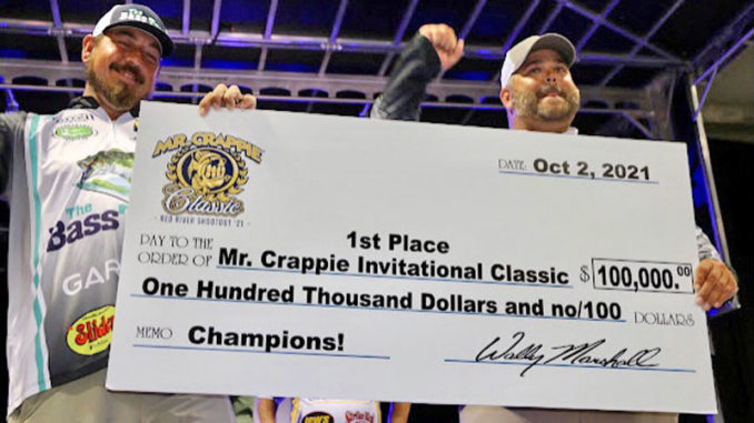 Winners Jeff Larch and Jared Fyock of Arkansas with their $100,000 Crappie Classic championship check.